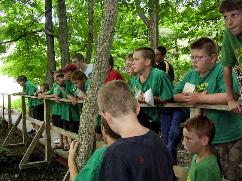 Boy campers standing on a bridge
