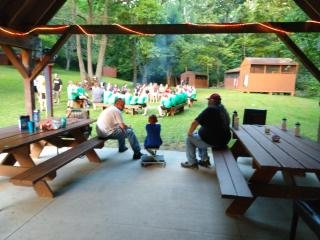 mealtime at camp o'bannon everyone sitting outside at picnic tables